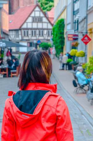 woman looking around Schwerin's Old Town