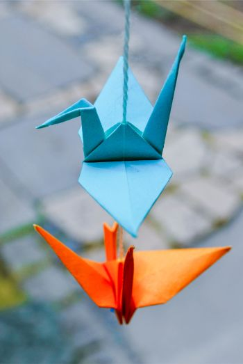 origami cranes in orange and blue at Japanese Garden in Bad Langensalza, Germany