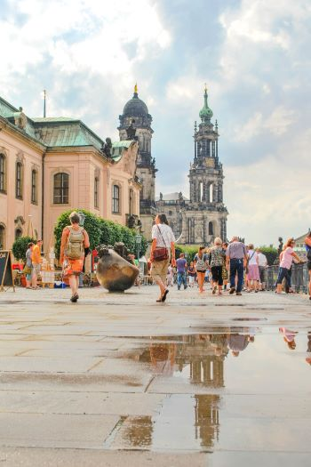 Brühl Terrace in Dresden with puddles reflecting the cathedral