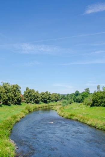 green river walks on a sunny summer day in Gera, Germany