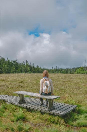 woman sitting on a bench in the Harz region, Germany