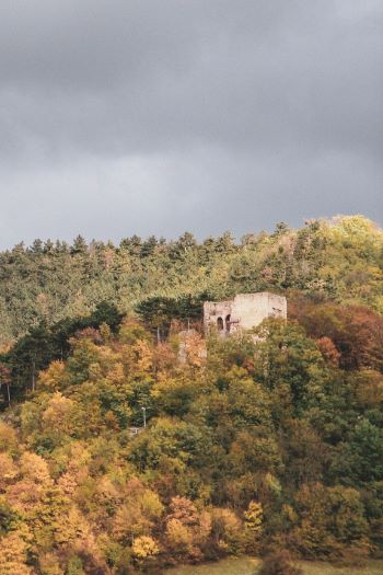 Lobdeburg Tower seen through colorful fall foliage from afar