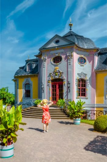 woman in front of rococo Castle in Dornburg, Germany