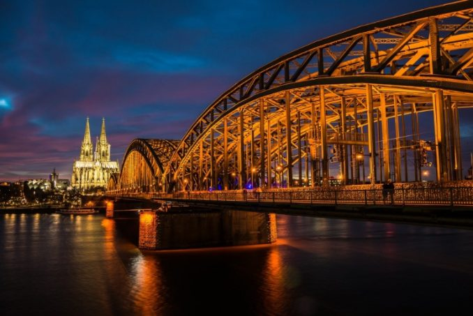 Cologne Cathedral and bridge illuminated at night, Germany