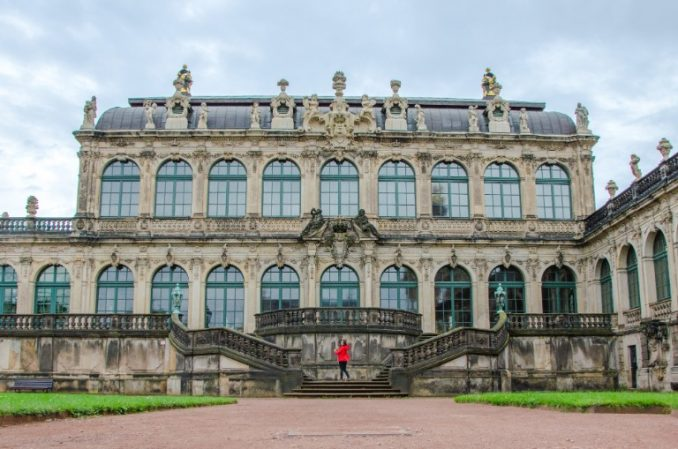 woman in red jacket standing in front of Dresden Zwinger